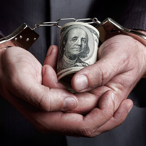 business-man-arrested-for-a-financial-crime